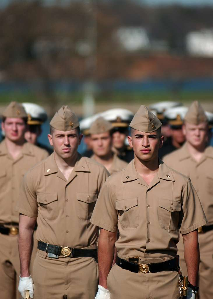 U.S. Naval Academy Midshipmen participate in a practice parade on the academy campus.