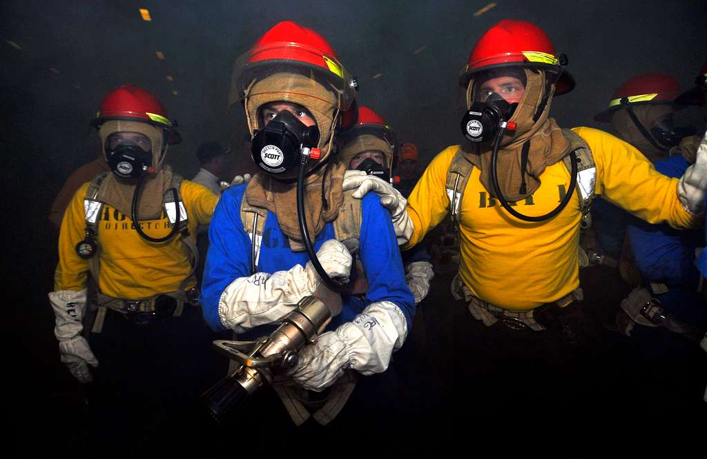 Sailors prepare to fight a simulated fire during a general quarters drill.