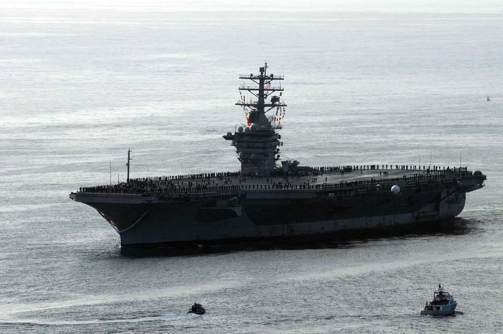 The aircraft carrier USS Nimitz (CVN 68) cruises around Point Loma on the way to Naval Base Coronado.