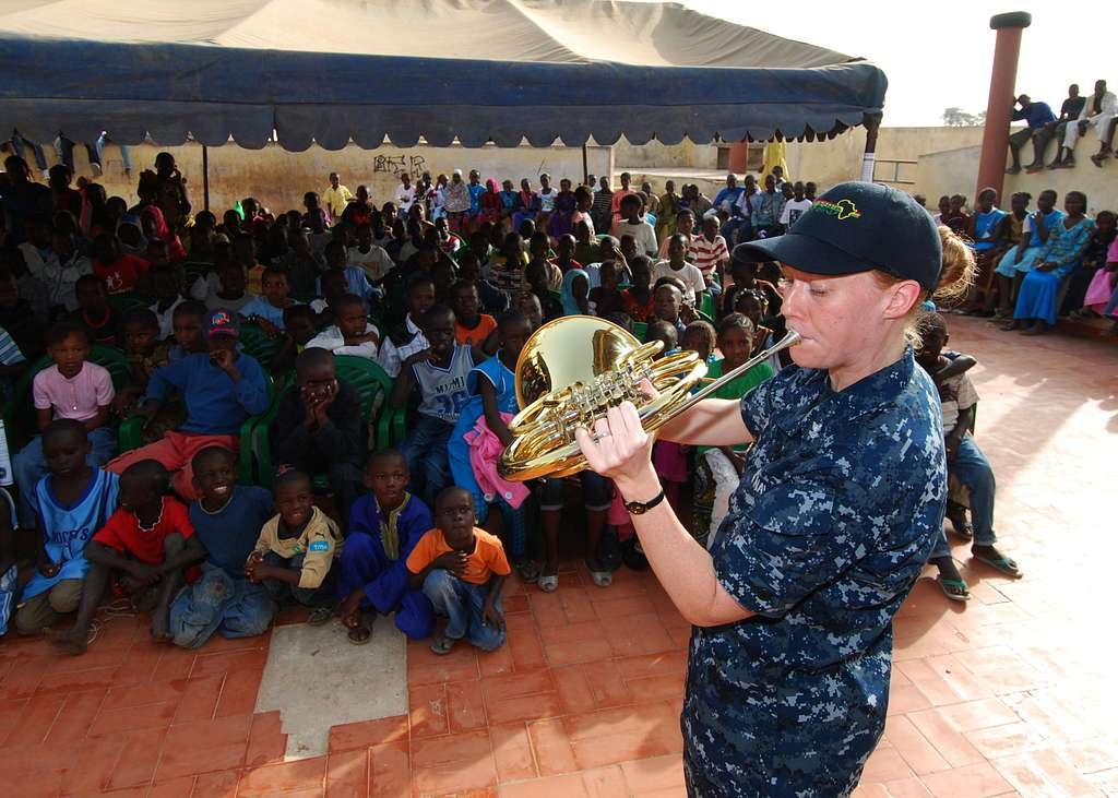 Musician 2nd Class Allison Baine performs for more than 300 children at the Colin Powell Cultural Center.