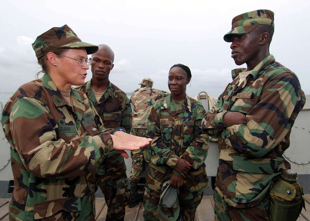 Capt. Cindy Thebaud, commander of Africa Partnership Station (APS) West, speaks to Armed Forces of Liberia Coast Guardsmen while transiting to the amphibious dock-landing ship USS Gunston Hall (LSD 44).