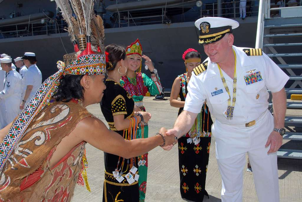 Capt. Rudy Luptin, commanding officer of the U.S. 7th Fleet command ship USS Blue Ridge (LCC 19), is greeted by a Malaysian native upon the ships arrival in Sepangar, Malaysia.