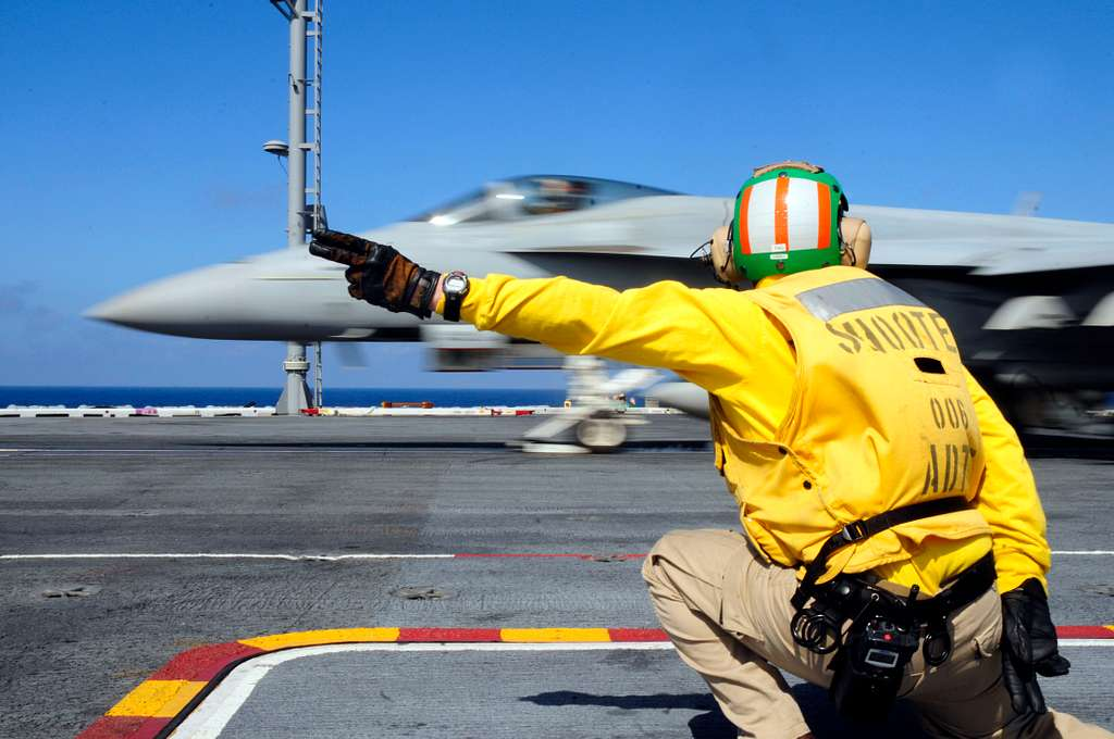 Lt. Edward Morelli launches an F/A-18 Super Hornet from the flight deck of the Nimitz-class aircraft carrier USS Carl Vinson (CVN 70).