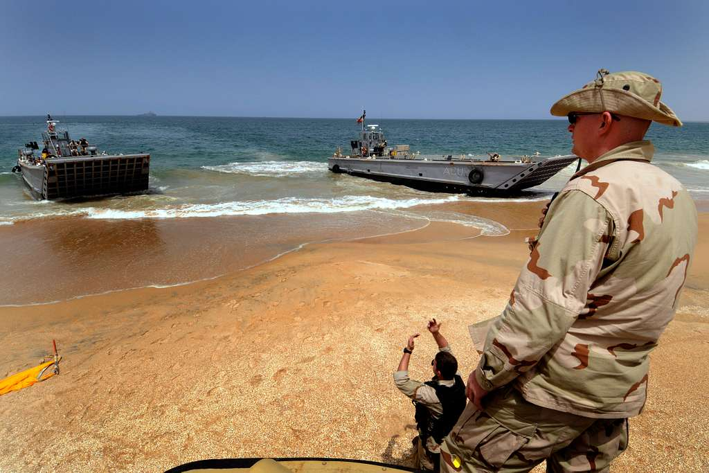 Gunner's Mate 2nd Class Michael Magrames watches the offload of U.S, Spanish, Portuguese and British marines.