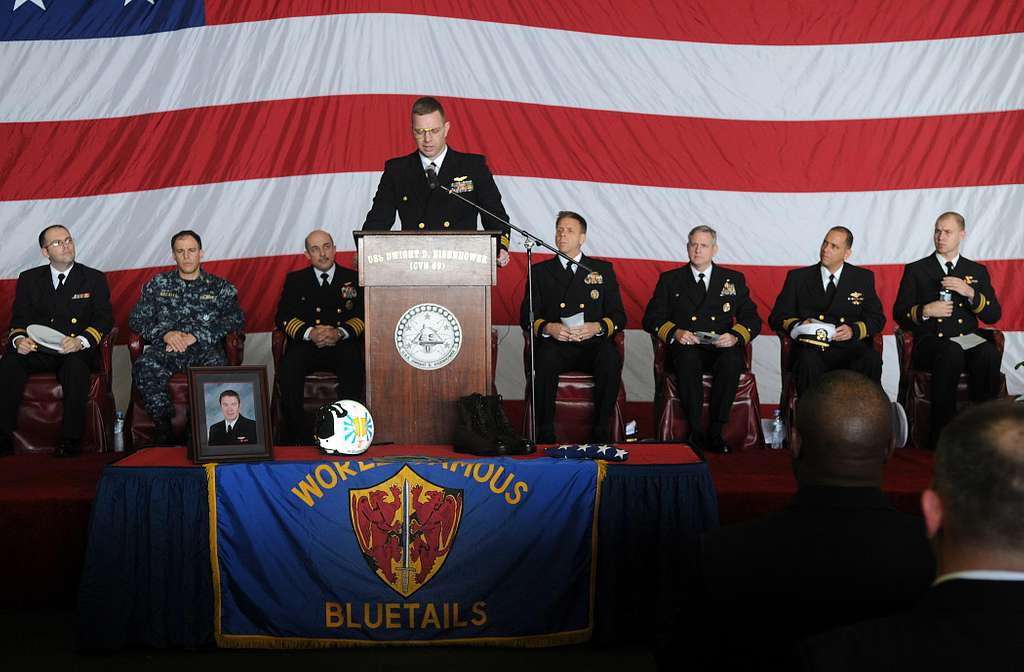 Cmdr. Joseph Finn, commanding officer of Carrier Airborne Early Warning Squadron (VAW) 121, delivers remarks during a memorial service for Lt. Steven Zilberman aboard the aircraft carrier USS Dwight D. Eisenhower (CVN 69).