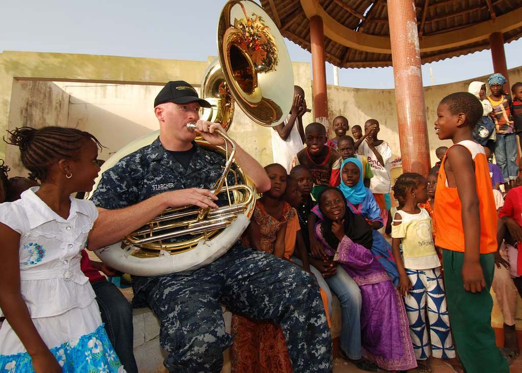 Musician 1st Class Roger Starcher performs for more than 300 children at the Colin Powell Cultural Center.