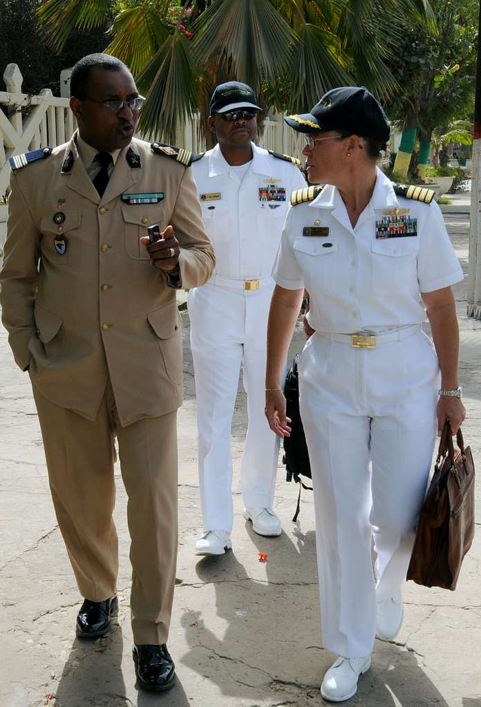 Senegal army Col. Antoine Wardini, left, speaks with Capt. Cindy Thebaud, commander of Africa Partnership Station (APS) West.