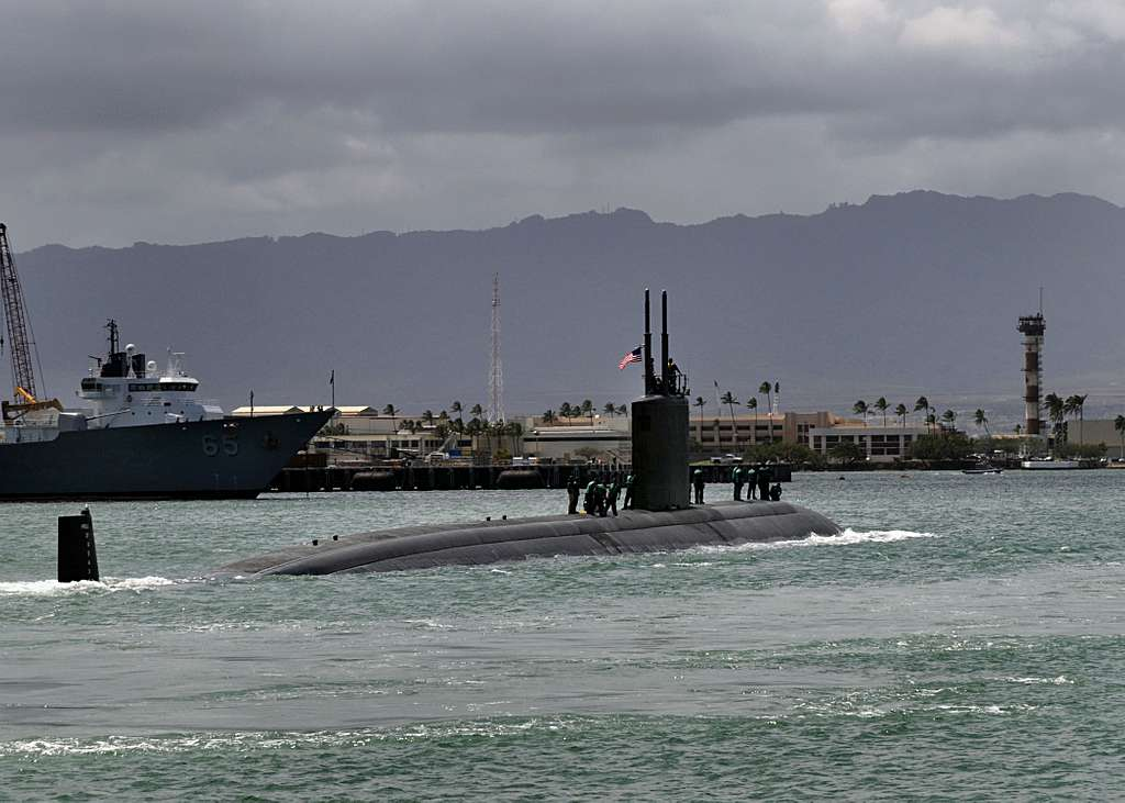 The Los Angeles-class submarine USS Tucson (SSN 770) departs Joint Base Pearl Harbor-Hickam for a scheduled deployment to the western Pacific region.
