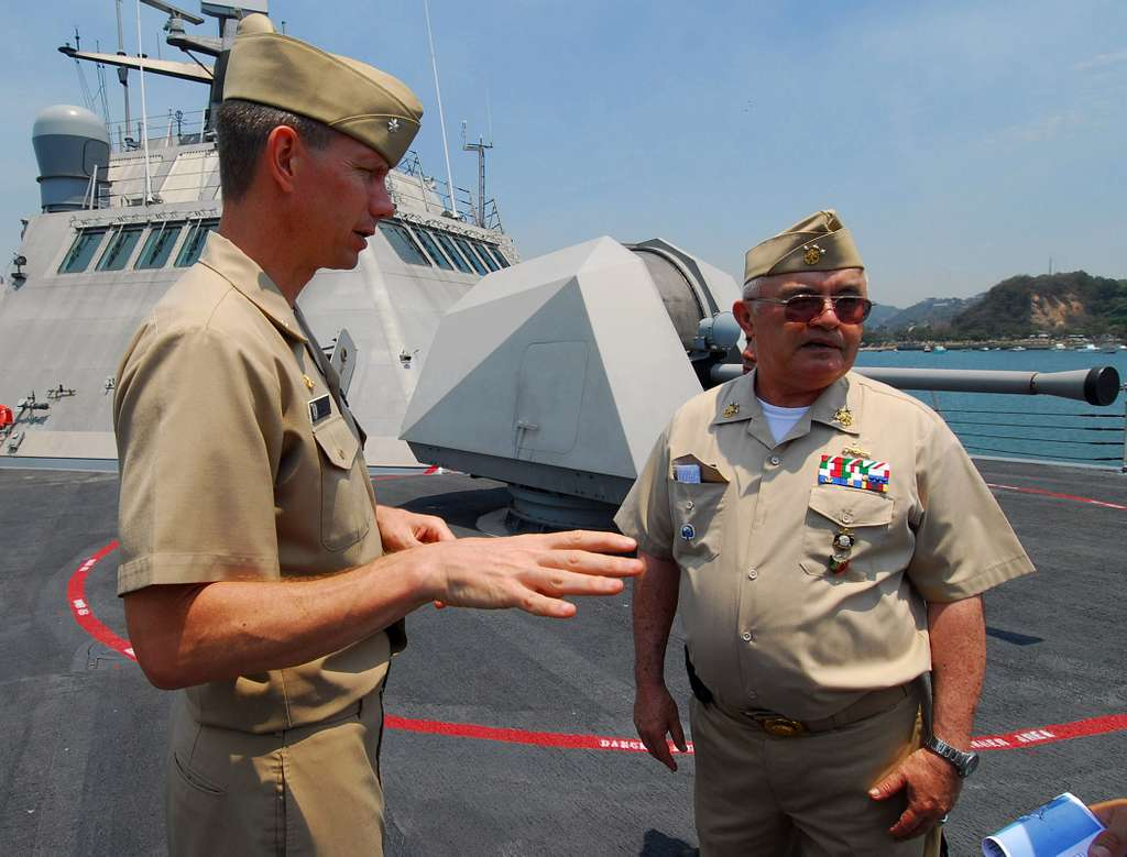 Cmdr. Randy Garner explains the targeting system for USS Freedom (LCS 1) to Mexican navy Adm. Nestor Yee.