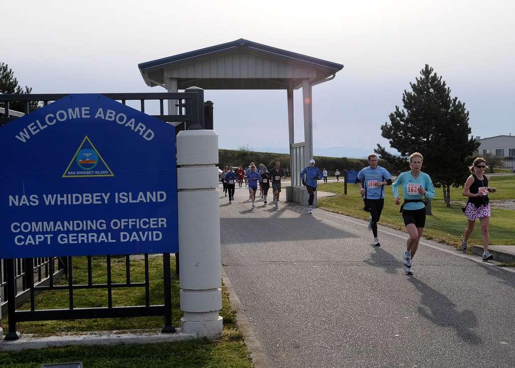 Runners exit through Maui Gate at Naval Air Station (NAS) Whidbey Island Seaplane Base during the 9th Annual Whidbey Island Marathon/Half-Marathon.