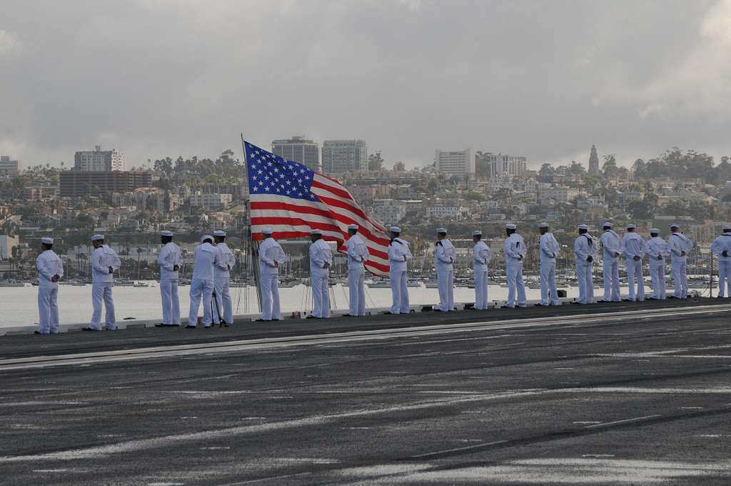 Sailors aboard the Nimitz-class aircraft carrier USS Carl Vinson (CVN 70) man the rails as the ship transits Turning Basin toward its new homeport of Naval Air Station North Island in San Diego.