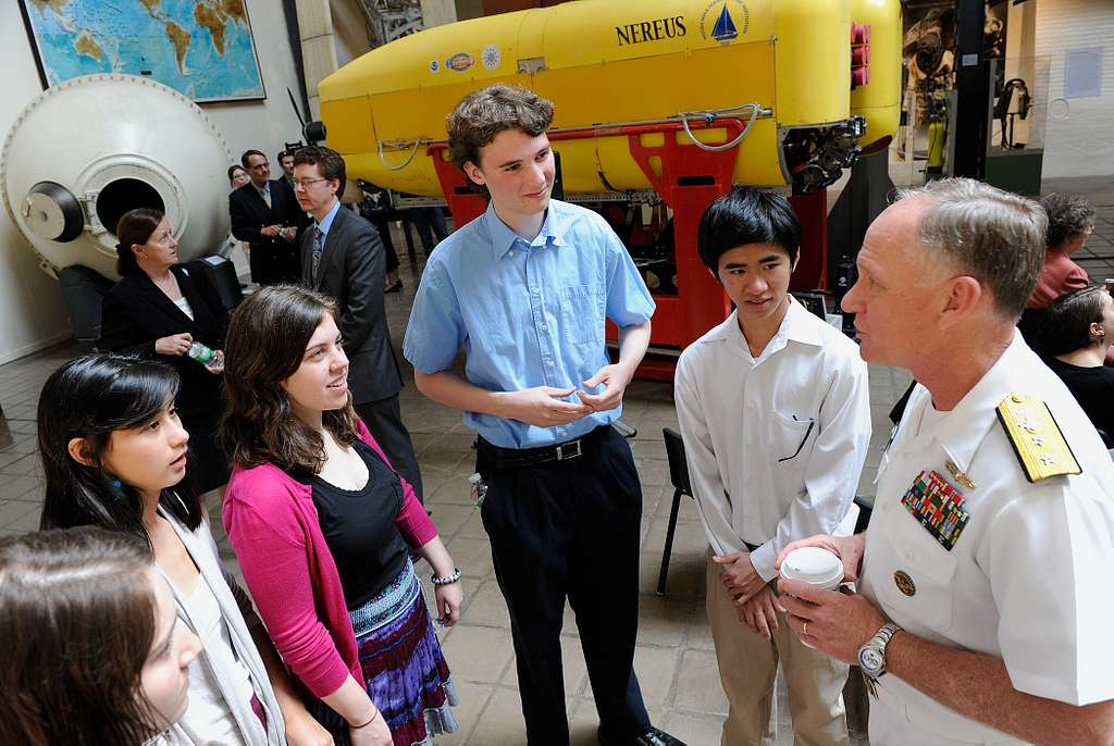 Rear Adm. Nevin Carr, Chief of Naval Research, discusses undersea science and technology with students from Wilson High School.