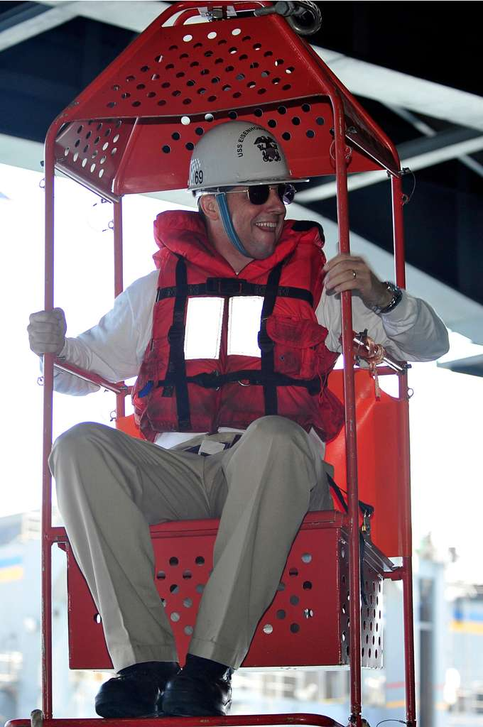 Capt. Ted Williams, executive officer of the aircraft carrier USS Dwight D. Eisenhower (CVN 69), rides a transfer chair back from the Military Sealift Command fast combat support ship USNS Supply (T-AOE 6).