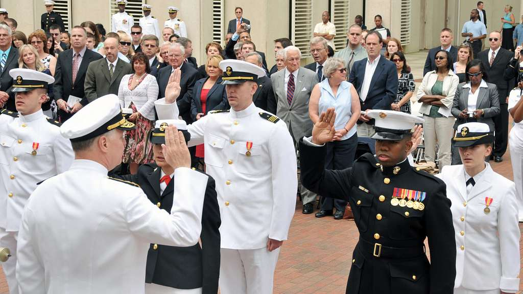 Chief of Naval Operations (CNO) Adm. Gary Roughead administers the oath of office to 10 Navy and Marine Corps ROTC midshipmen.