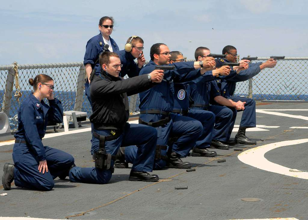 Sailors aboard the guided-missile destroyer USS Laboon (DDG 58) participate in the Beretta M-9 pistol qualification course to qualify for force protection watch standing.