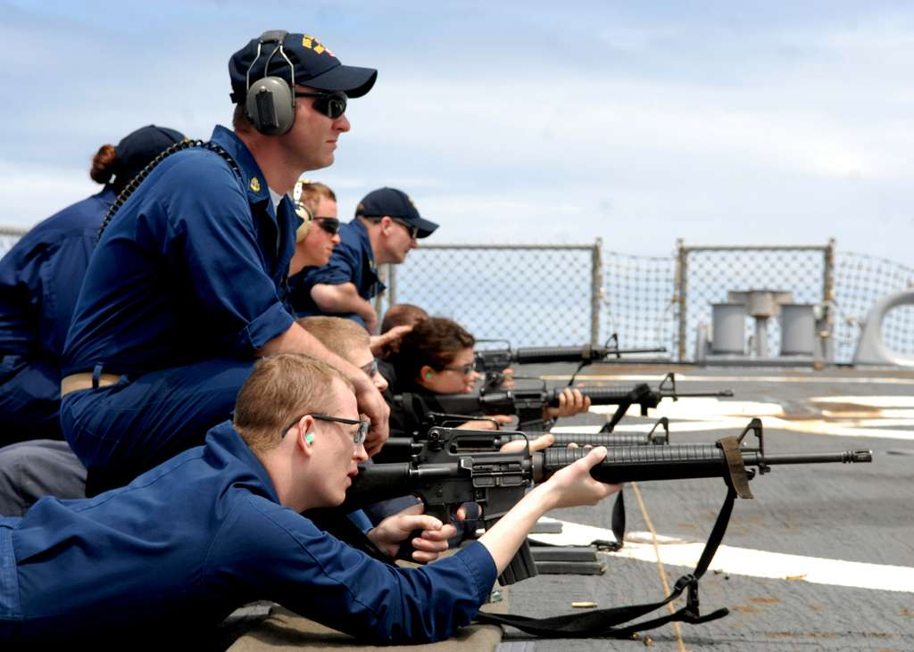 Chief Gunner's Mate Matthew Rayburn supervises the firing line during a weapons qualification.