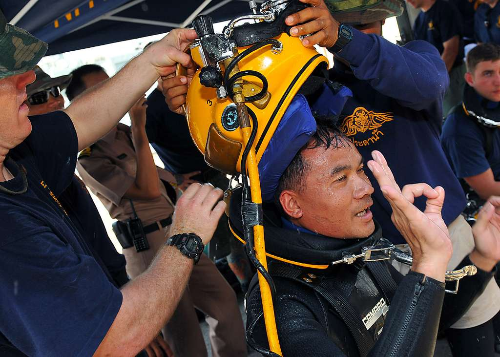 U.S. Navy Divers take the MK-21 diving helmet off Royal Thai Navy diver Petty Officer 1st Class Sarawut after completing a Cooperation Afloat Readiness and Training (CARAT) Thailand 2010 training dive.
