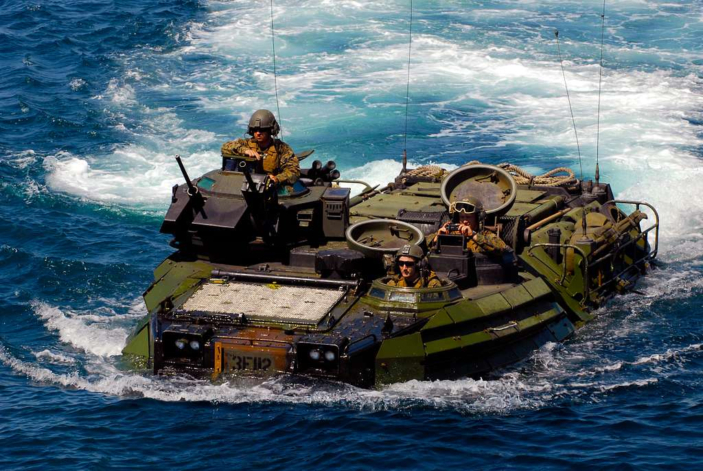 Marines from the 1st Battalion, 4th Marine Division return to the amphibious transport dock ship USS Dubuque (LPD 8).
