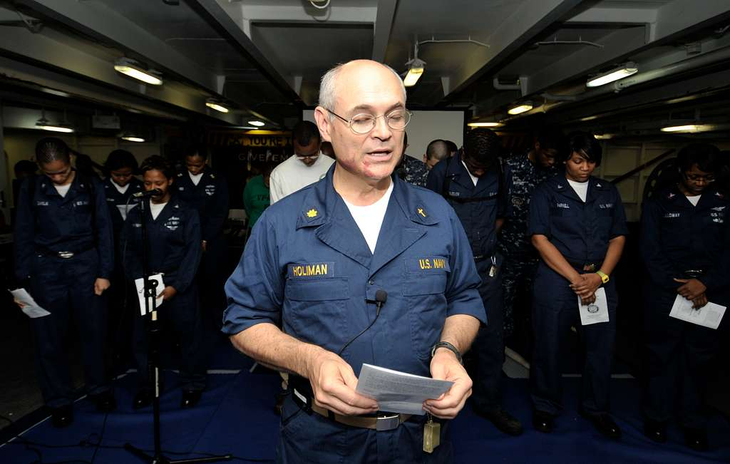 Lt. Cmdr. William Holiman, a chaplain aboard the aircraft carrier USS Harry S. Truman (CVN 75), leads the opening prayer for Sunday worship service.