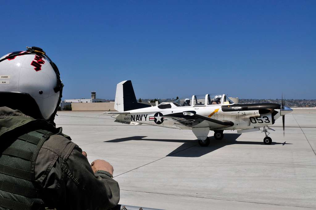 An ROTC midshipman prepares to take a ride in a T-35C training aircraft as part of Career Orientation Training for Midshipmen Aviation Week
