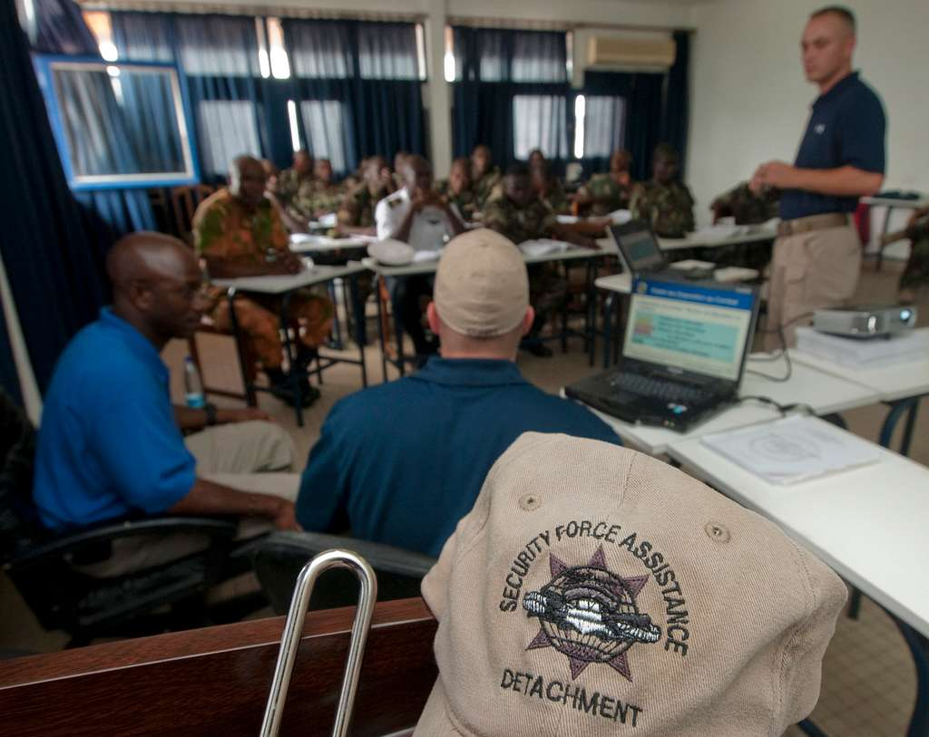 Instructors from the Maritime Civil Affairs and Security Training, Security Force Assistance (SFA) team, review anti-terrorism and force protection measures with members of the Cameroon navy at Douala Naval Base.