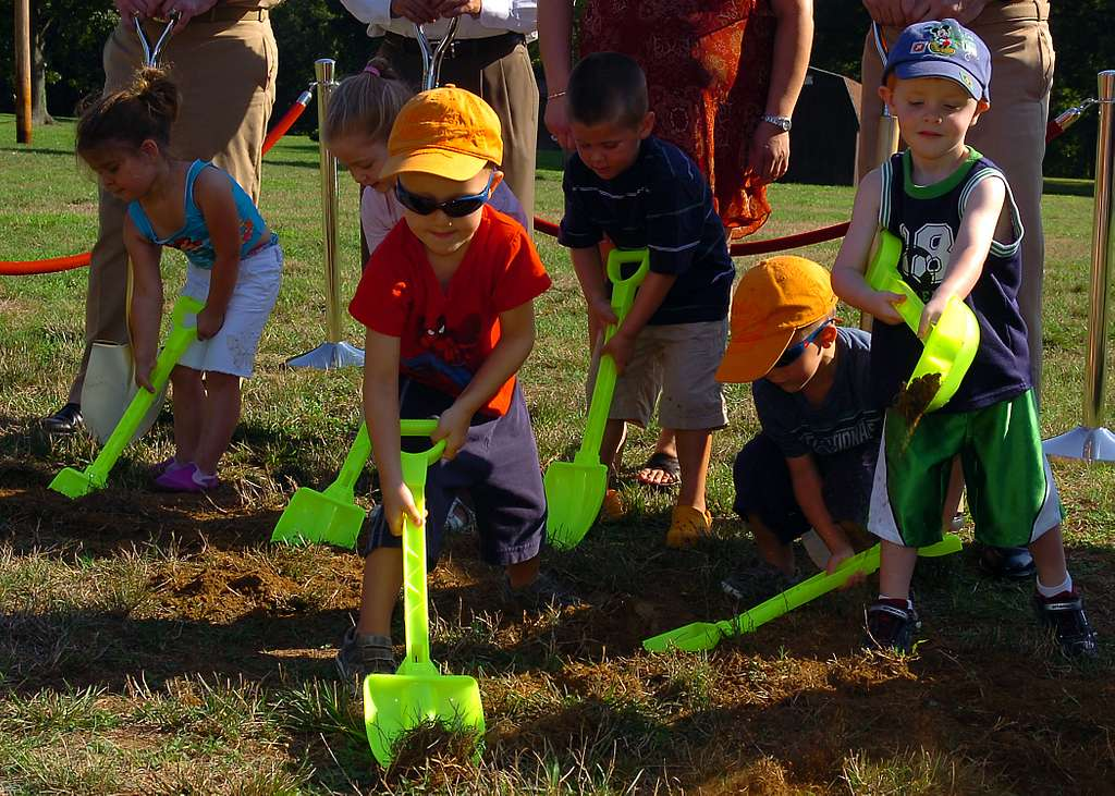 Children who attend the Child Development Center at Naval Support Activity Annapolis participate in a groundbreaking ceremony