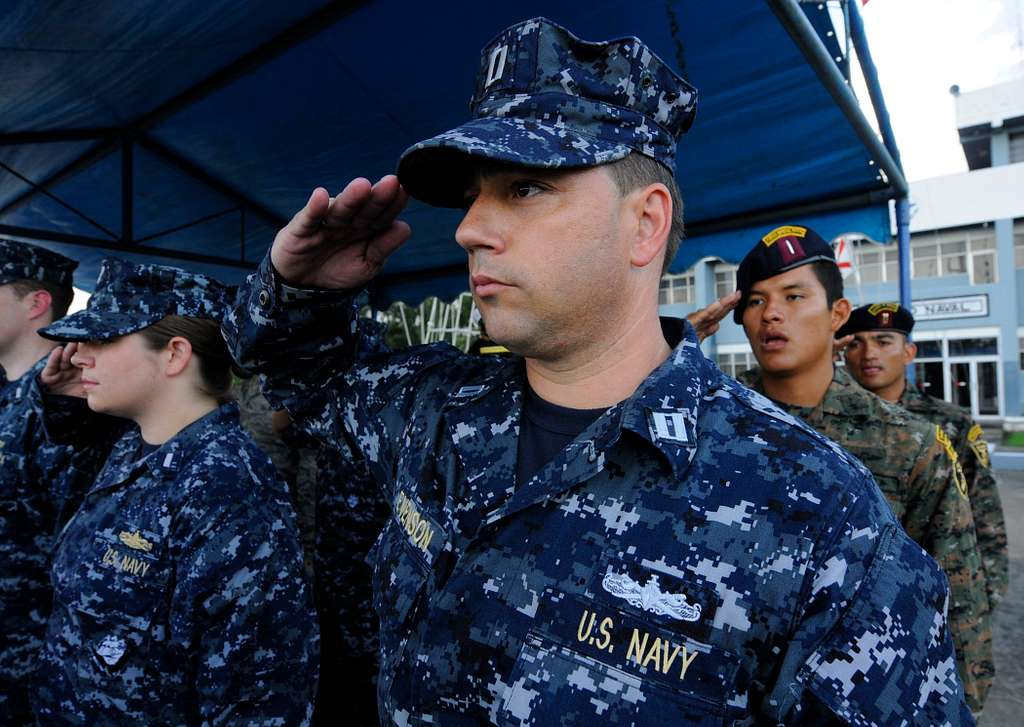 Lt. Sean Evenson salutes during the national anthem at the Southern Partnership Station (SPS) 2010 closing ceremony in Guatemala.