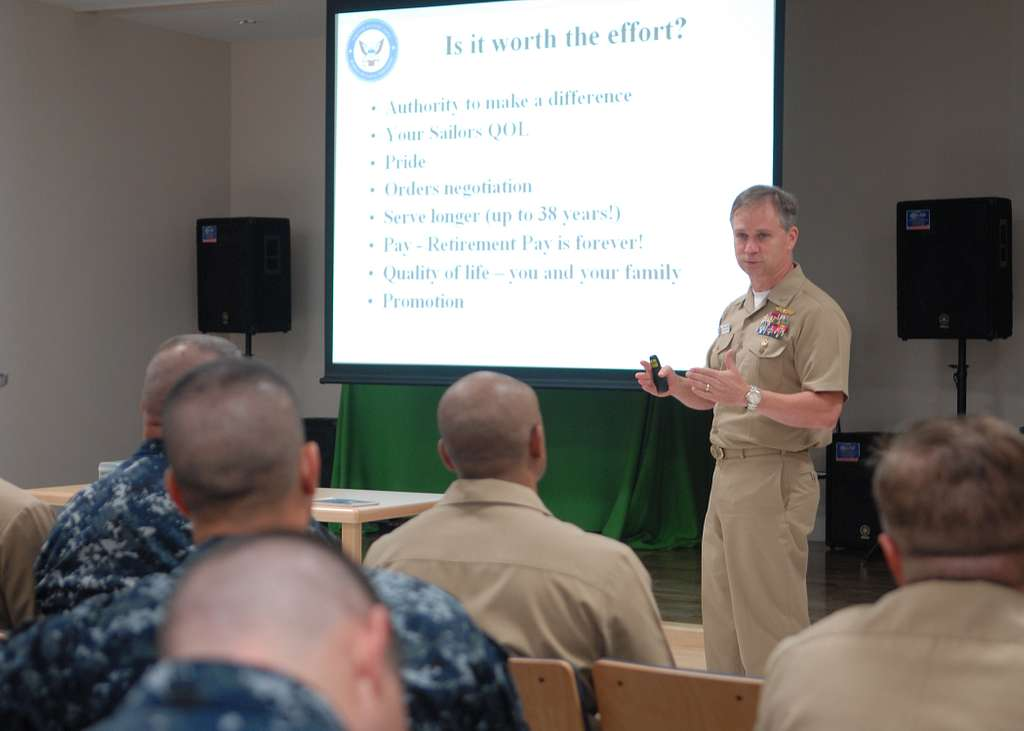 Capt. John Jones, chief warrant officer (CWO) and limited duty officer (LDO) community manager, briefs prospective CWOs and LDOs in the Community Readiness Center at Commander Fleet Activities Yokosuka.