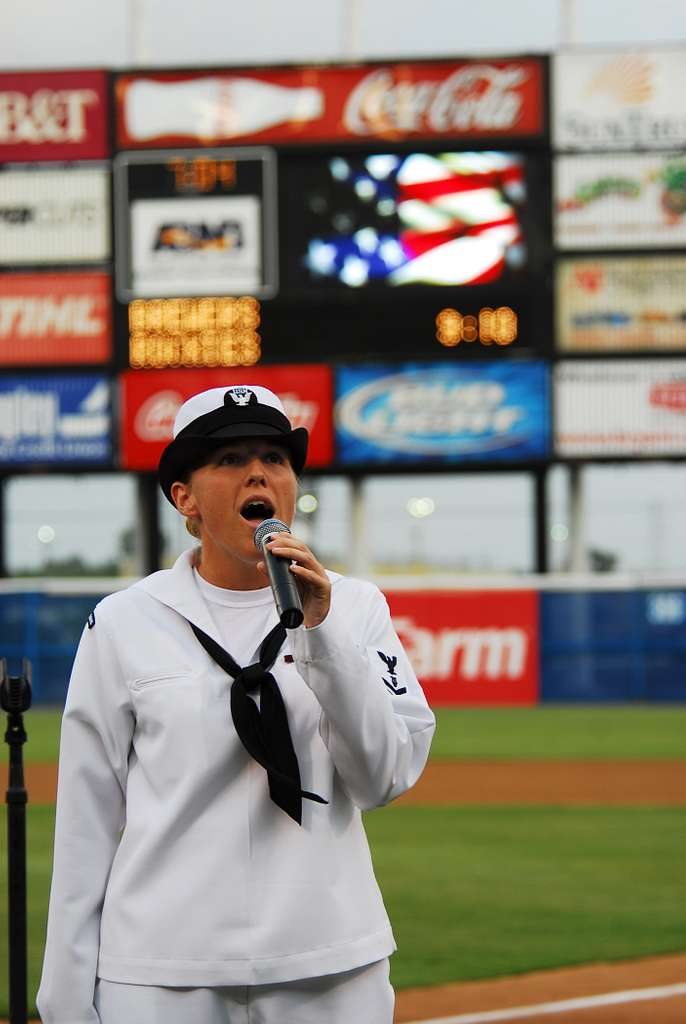 Musician 3rd Class Sarah Janiak sings the national anthem during the 2nd annual Navy Night at Harbor Park.