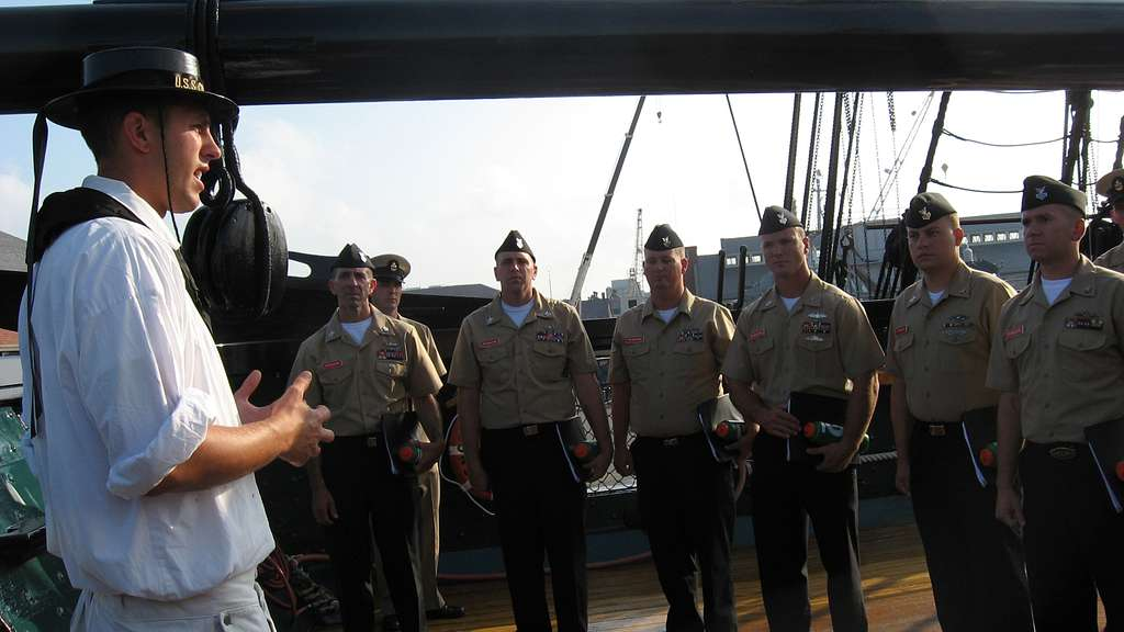 Builder 3rd Class Miles Trevor conducts a tour aboard USS Constitution for chief petty officer selectees assigned to Naval Station Newport, R.I.