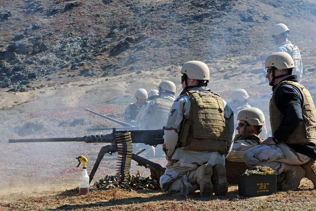 Navy Reserve Sailors fire an M2HB .50-caliber machine gun during a live-fire exercise.