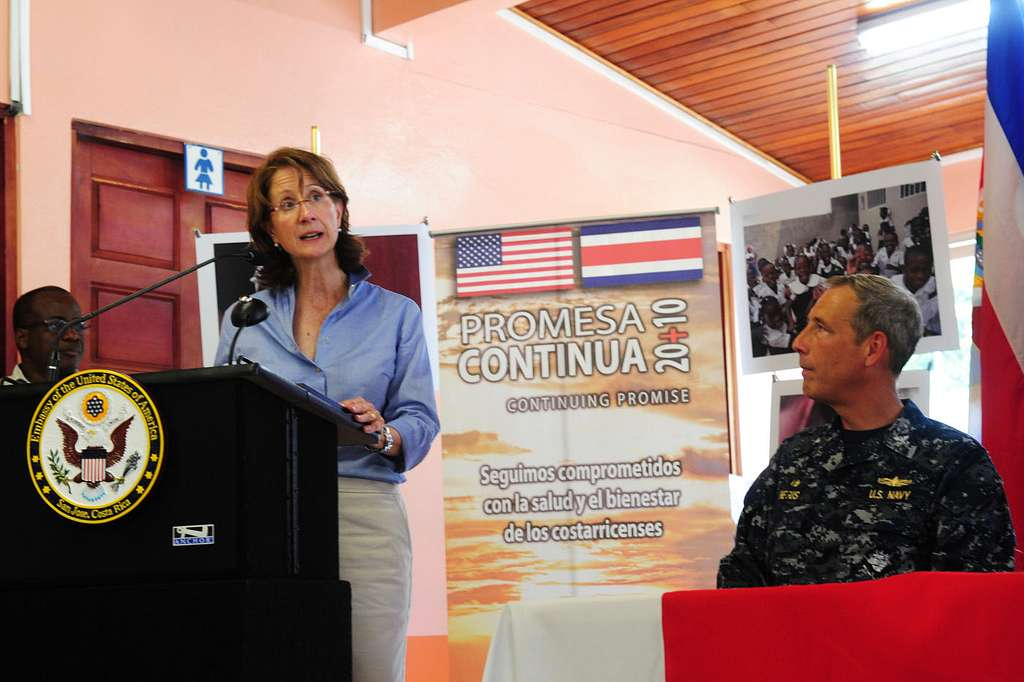 Capt. Thomas Negus, commodore of Continuing Promise 2010, watches as U.S. Ambassador to Costa Rica Anne Andrews delivers remarks during the opening ceremony of the Costa Rica phase of Continuing Promise 2010.