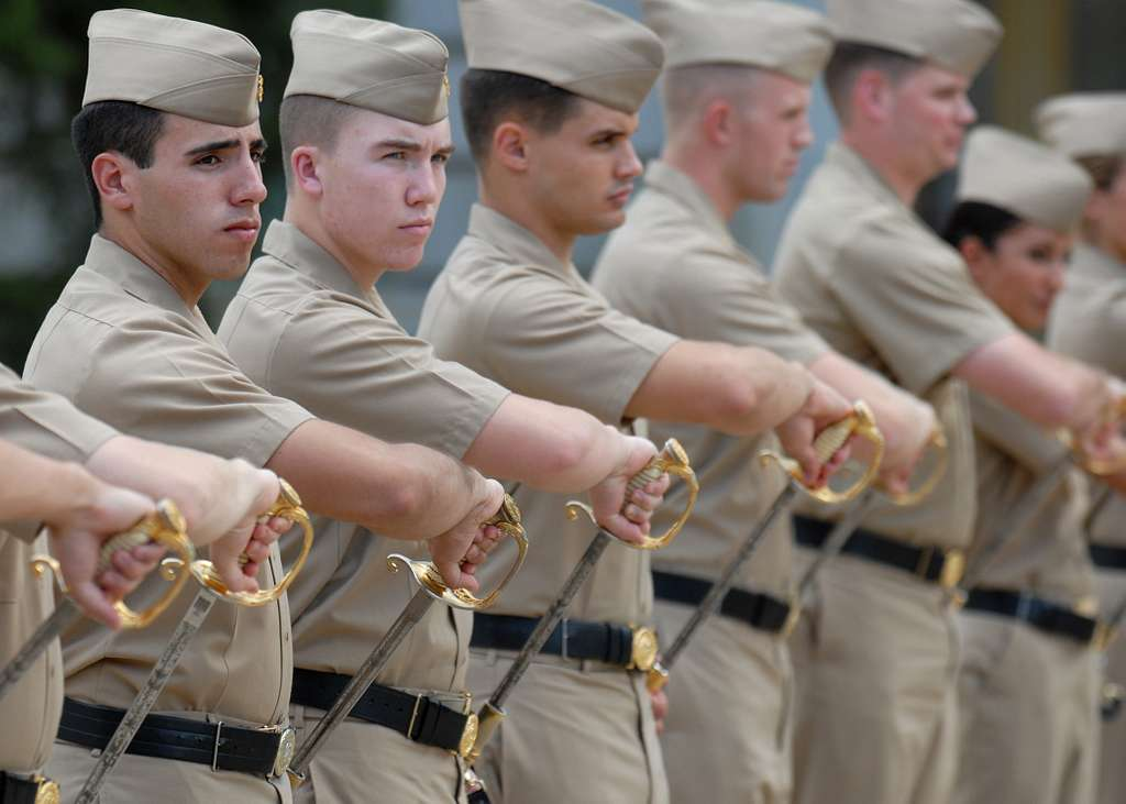 U.S. Naval Academy Midshipmen stripers receive drill instruction in Techumseh Court on the school's campus.