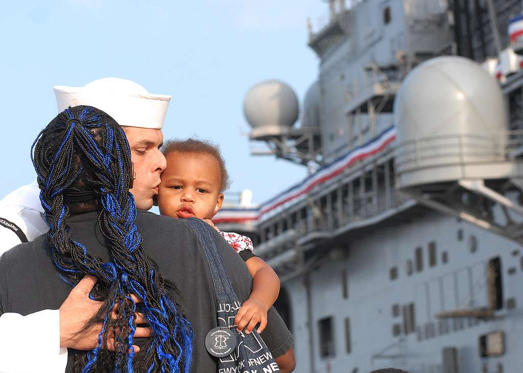 A Sailor says good-bye to his family before boarding the amphibious assault ship USS Kearsarge (LHD 3) to depart on a U.S. humanitarian mission to Pakistan in support of flood relief efforts.