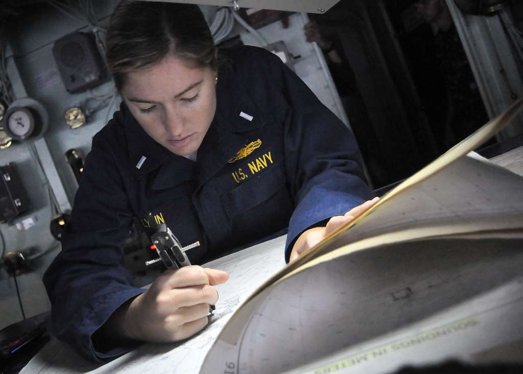 Lt. j.g. Brittany Lynn plots a course to an anchorage point from the pilothouse of USS Denver (LPD 9).