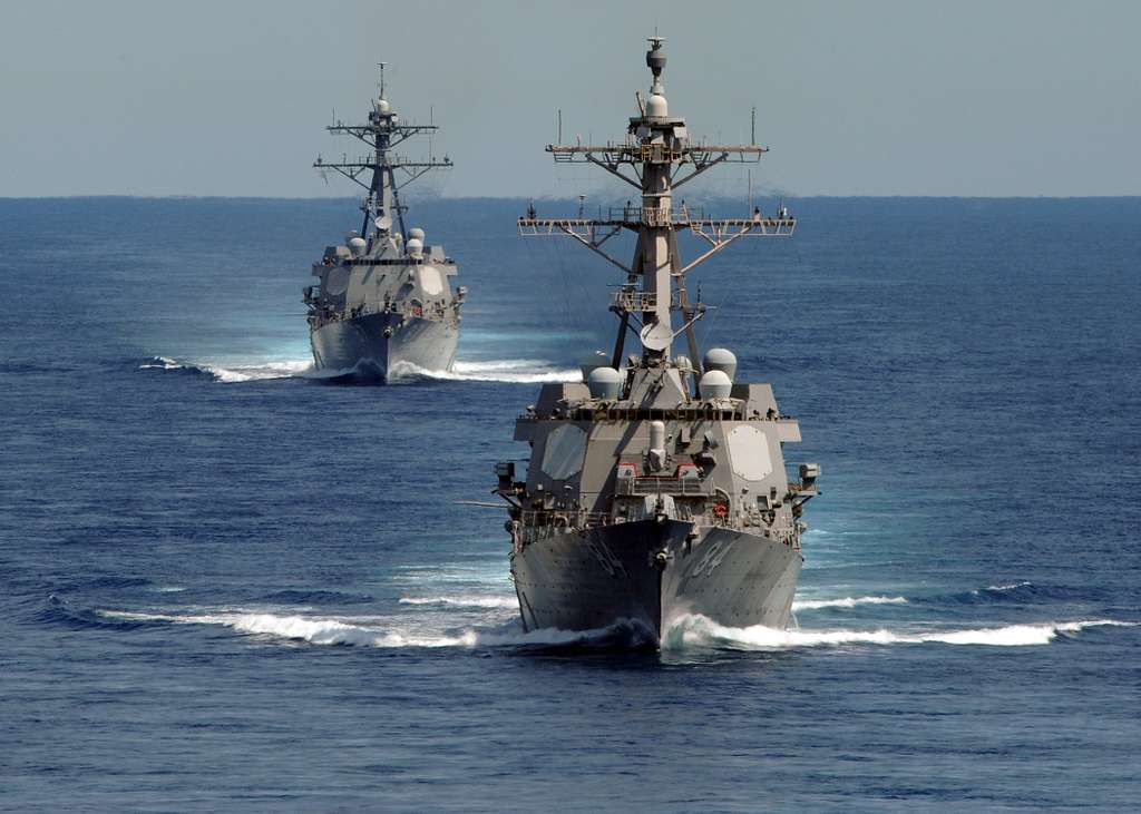 USS Bulkeley (DDG 84), right, and USS Mason (DDG 87) participate in a strait transit exercise.