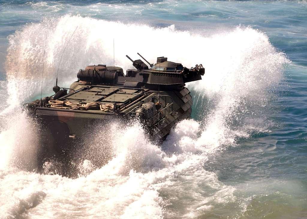 An amphibious assault vehicle launches from the well deck of USS Denver (LPD 9).