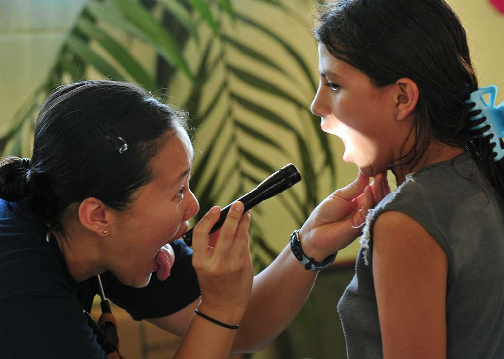 Lt. Amanda Higginson, from Bethesda, Md., examines a Guatemalan girl during a Continuing Promise 2010 medical civic event