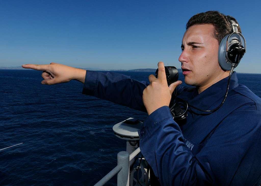 Seaman Apprentice James Anthony stands lookout watch aboard USS Kearsarge (LHD 3) as the ship transits the Strait of Gibraltar.