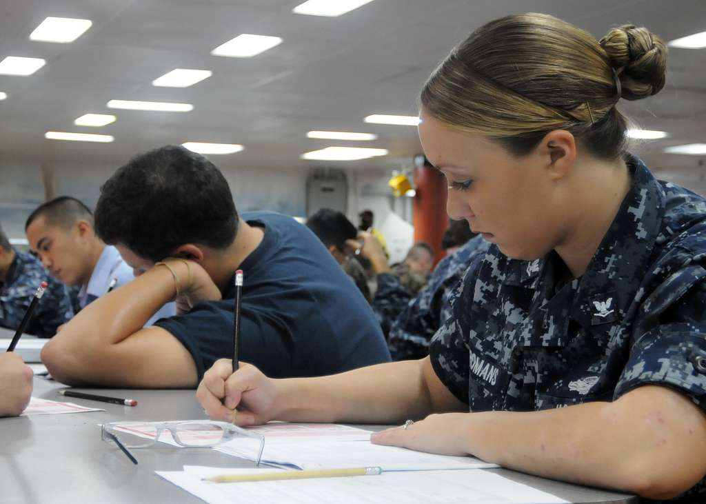 Master-at-Arms 3rd Class Crystal Romans takes the Navy-wide E-5 exam aboard the forward deployed amphibious assault ship USS Essex (LHD 2).