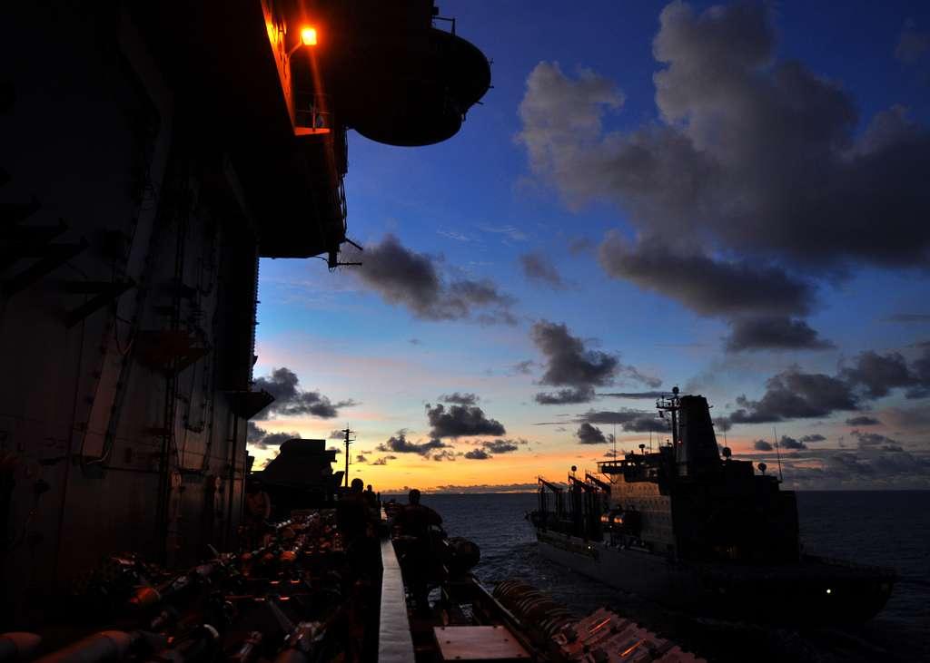 The aircraft carrier USS George Washington (CVN 73) pulls alongside the Military Sealift Command dry cargo and ammunition ship USNS John Ericsson (T-AO 194)