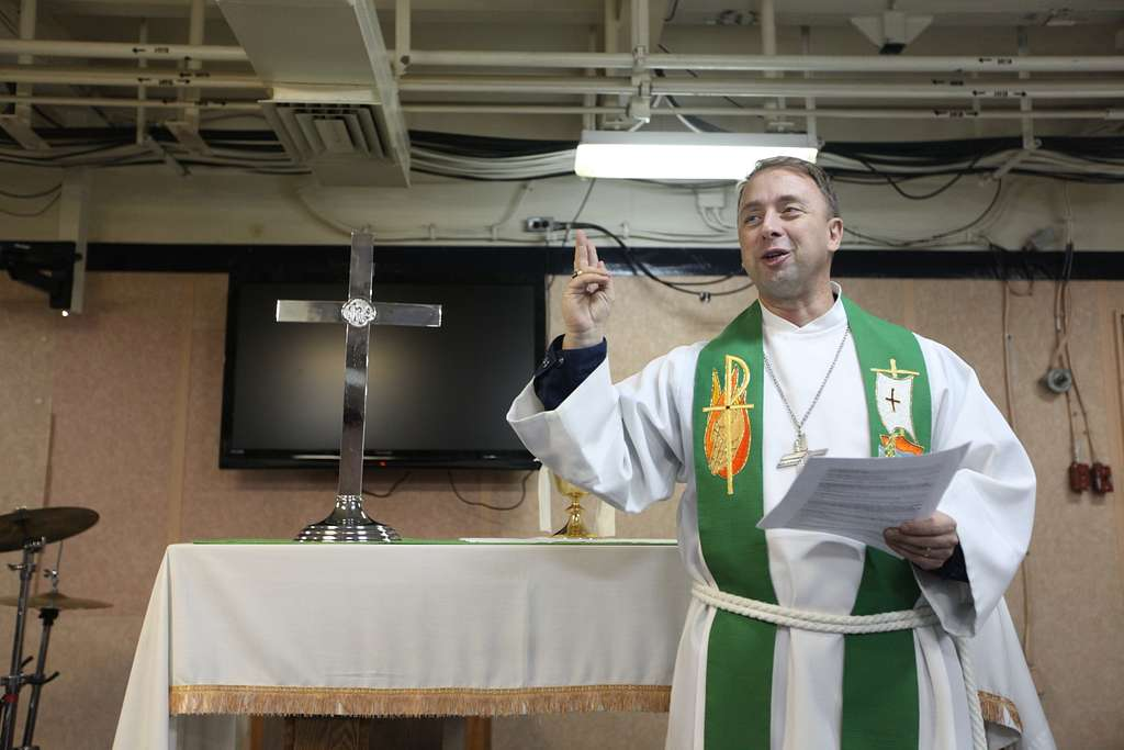 A command chaplain holds chuch services aboard USS Kearsarge.