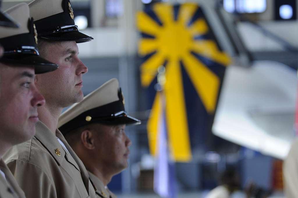 Chief Mass Communication Specialist Joe Pfaff, center, assigned to Fleet Combat Camera Group Pacific,