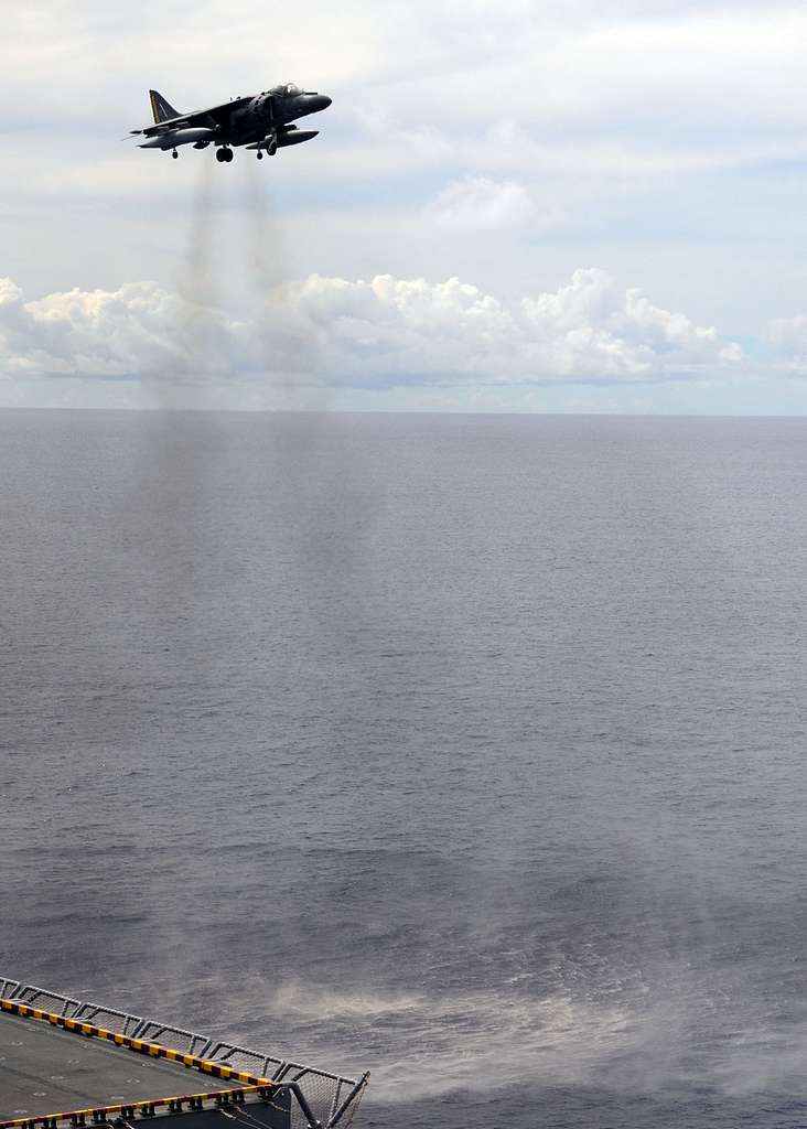 Harrier jet lands aboard USS Essex.