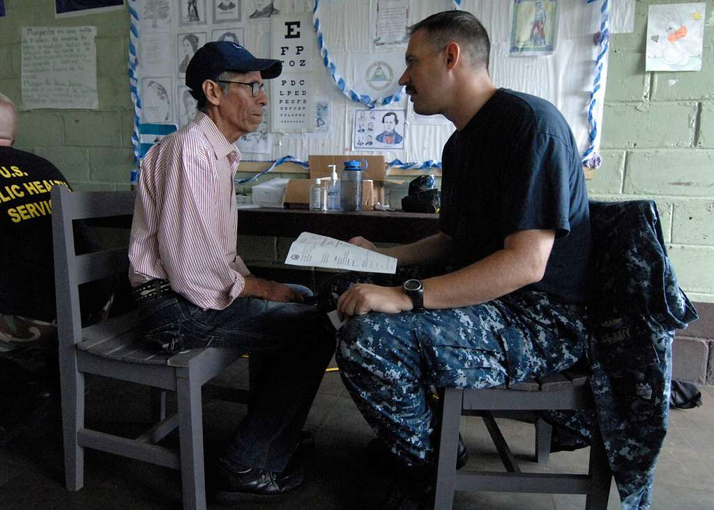 Lt. Cmdr. Tyler Miles, embarked aboard the multi-purpose amphibious assault ship USS Iwo Jima (LHD 7), talks to a patient about his eyesight during a Continuing Promise 2010 medical community service project.