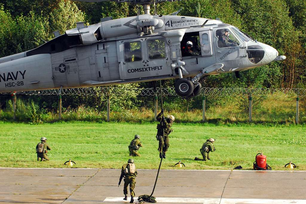 Special operations forces soldiers from Lithuania, Poland, and the U.S. conduct fast rope training from a U.S. Navy MH-60 Sea Hawk