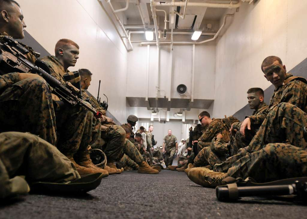 Marines assigned to the 31st Marine Expeditionary Unit (31st MEU) prepare for a simulated air raid aboard the forward-deployed amphibious assault ship USS Essex (LHD 2).