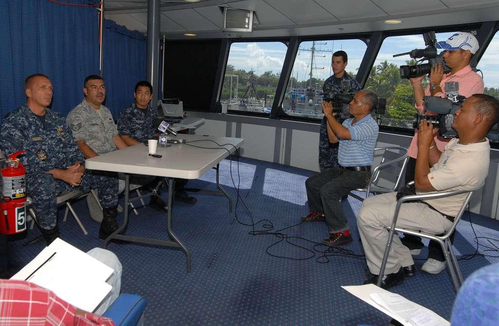 Capt. Kurt Hedberg, left, mission commander of Southern Partnership Station 2010 participates in a press conference aboard High Speed Vessel Swift (HSV 2).