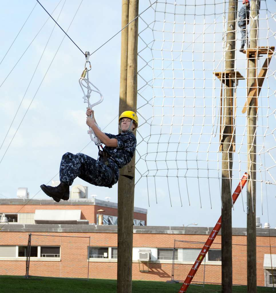 Officer Candidate Molly Carrigan, from Reno, Nev., zips down a line on the final station of the new 39-foot-tall high ropes