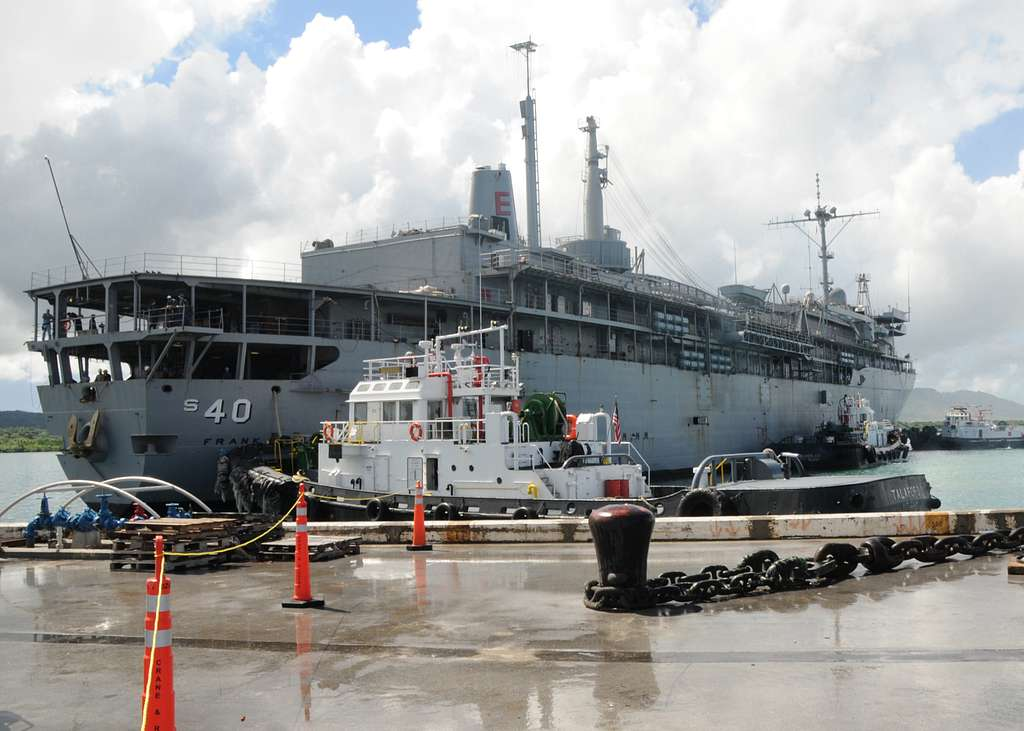 The submarine tender USS Frank Cable (AS 40) moves through Apra Harbor from Guam Shipyard to her normal berth at Polaris Point.